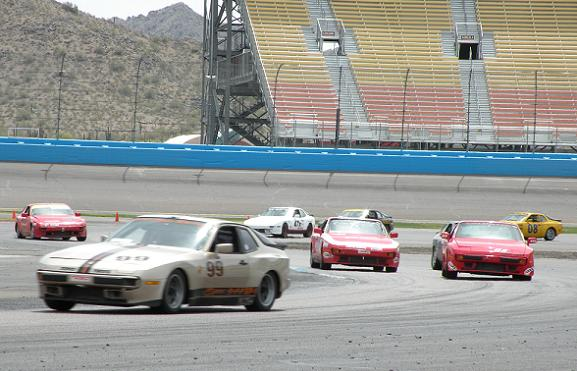 944 Spec cars entering the PIR infield after taking the green flag.