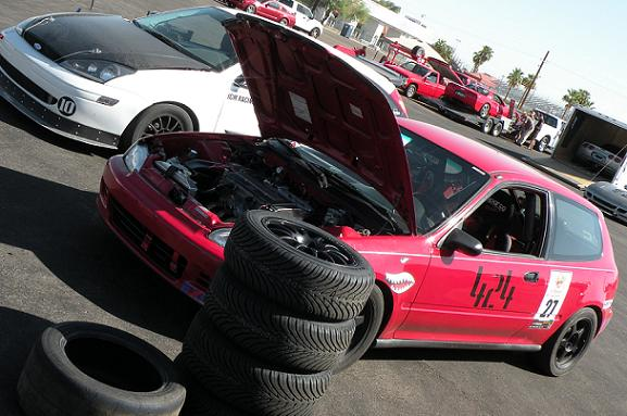 An economy car with a stack of tires changed at the track--the true grassroots way!