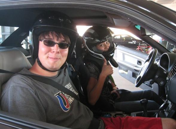 Melissa Tellez gives a racing fan a spin around PIR on October 3rd.