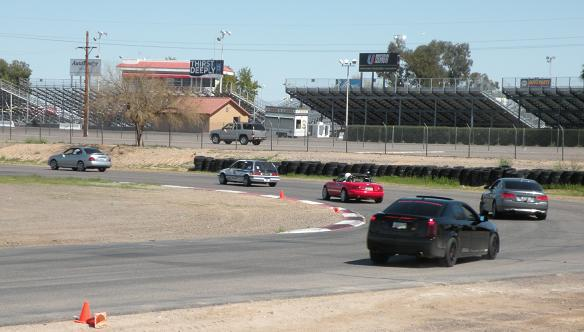 HPDE drivers circle around onto the front straight at Firebird West