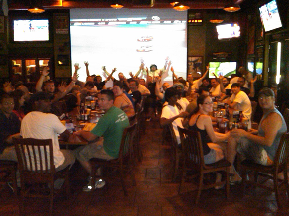 A gathering of 40 meet at the Tilted Kilt for post-track day jubilations!