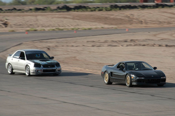 Markos gives Ravi a good chase during an HPDE session.